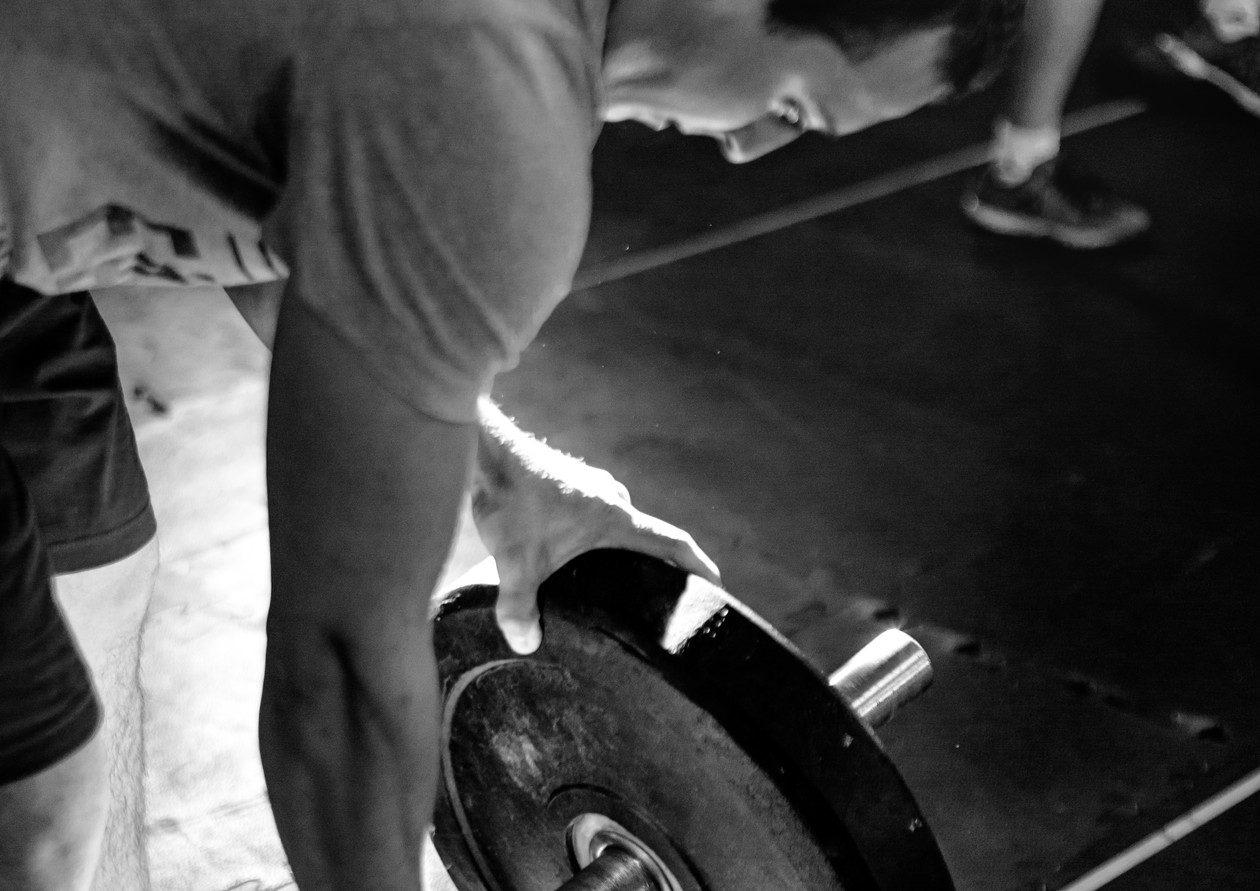 Loading a barbell to make a deadlift