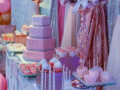 Pink princess cake and treat table setup
