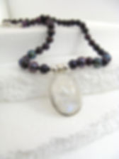black pearl necklace with silver set moonstone pendant