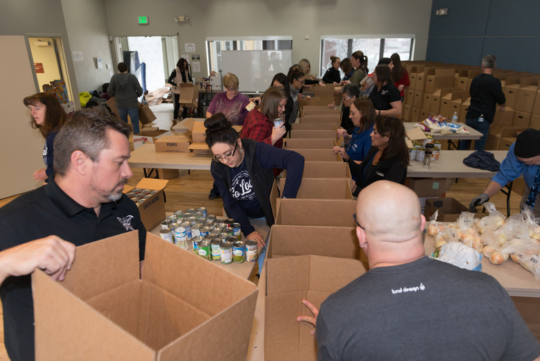 Volunteers Help Assemble Thanksgiving Food Boxes