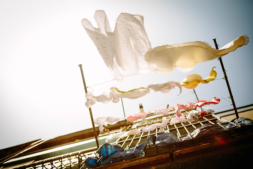 Laundry and linens air drying in the sun