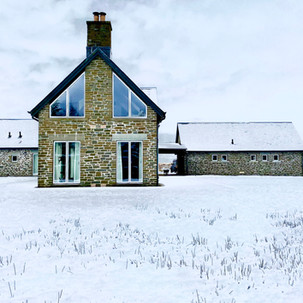 Gable end view of the Lodge and side view of the Bothy