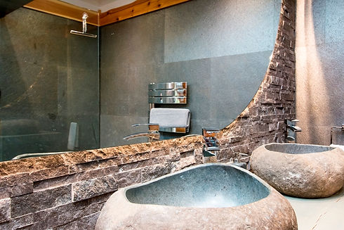 rock basins designer back lit heated mirror slate wall and floor shower room