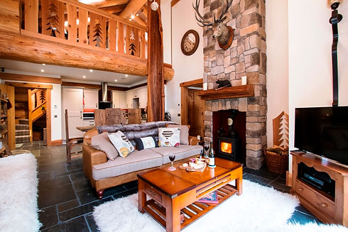 leather Harris tweed sofa games table log burner stone chimney brest cedar ballustrade