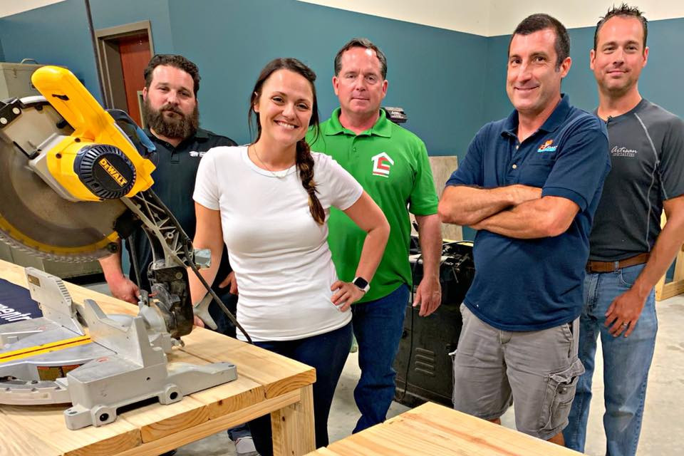 Members of MGA celebrated the Ribbon Cutting for SLCC's Carpentry Program by donating a check to defray the cost of tuition for incoming carpentry students.