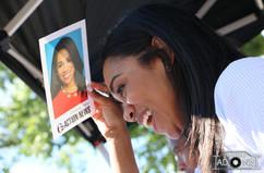 Christie Ileto shields the sun at the Manayunk Arts Festival