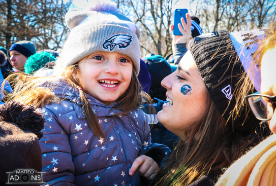 Girls cheer on the Eagles at the parade