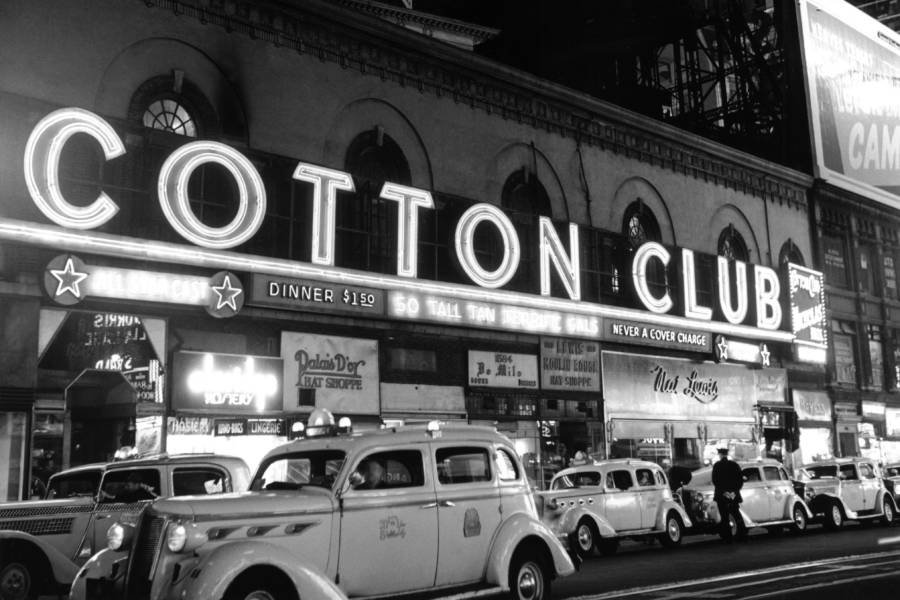 Taxis line up outside of the Cotton Club at Broadway and 48th Street, circa 1937 in New York City, New York.