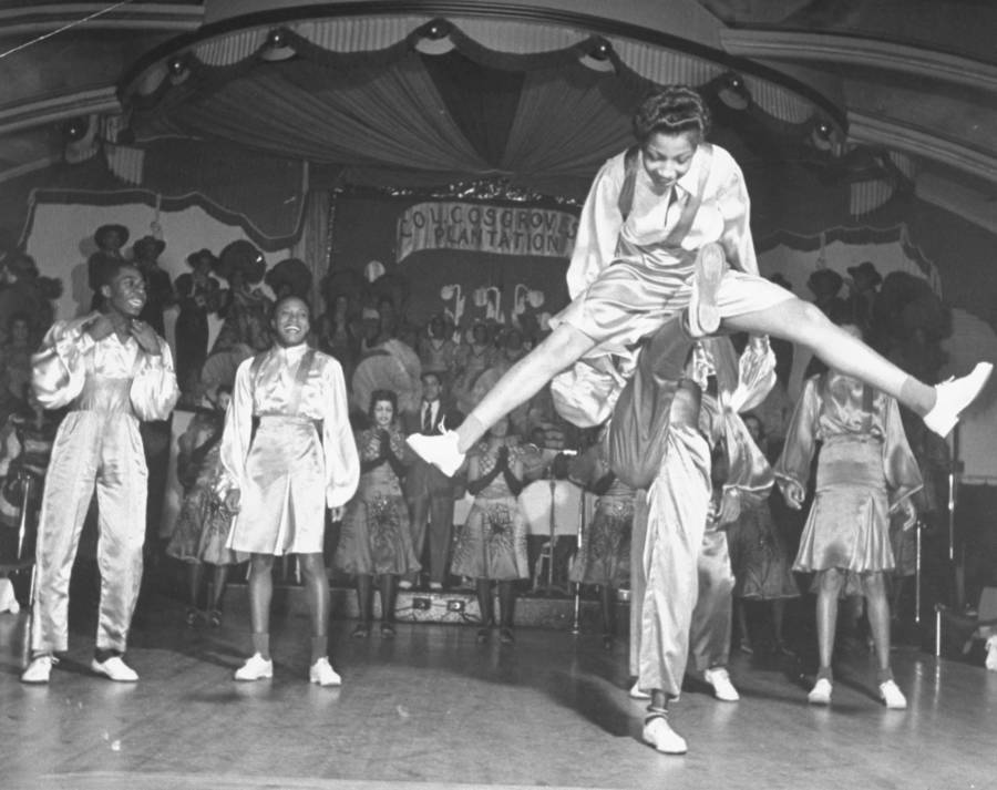 Acrobatic dancers performing onstage at the Cotton Club.