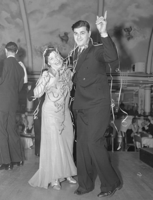 """Mr. and Mrs. Joseph Giambrone welcome the the New Year by doing the """"Big Apple"""" at the Cotton Club, 1937."""