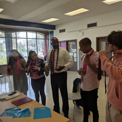 Students getting tie lesson from Keith L