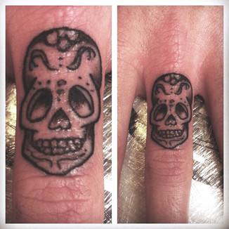 tiny skull on finger.jpg