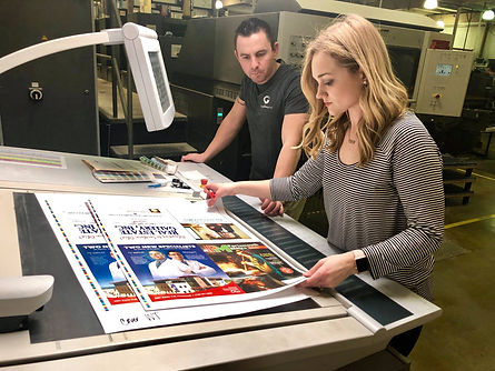 The Gallaher Group's graphic designer Courtney Lewis and pressman Mike Riffe do a press check to make sure colors are accurate.