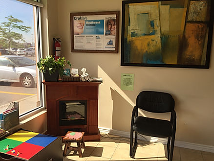Fire place and play area at Dentistry on Queenston, Hamilton, ON