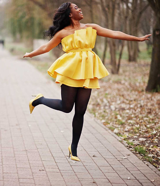beautiful african lady in yellow dress