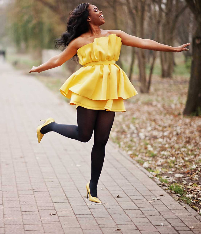 beautiful african lady in yellow dress