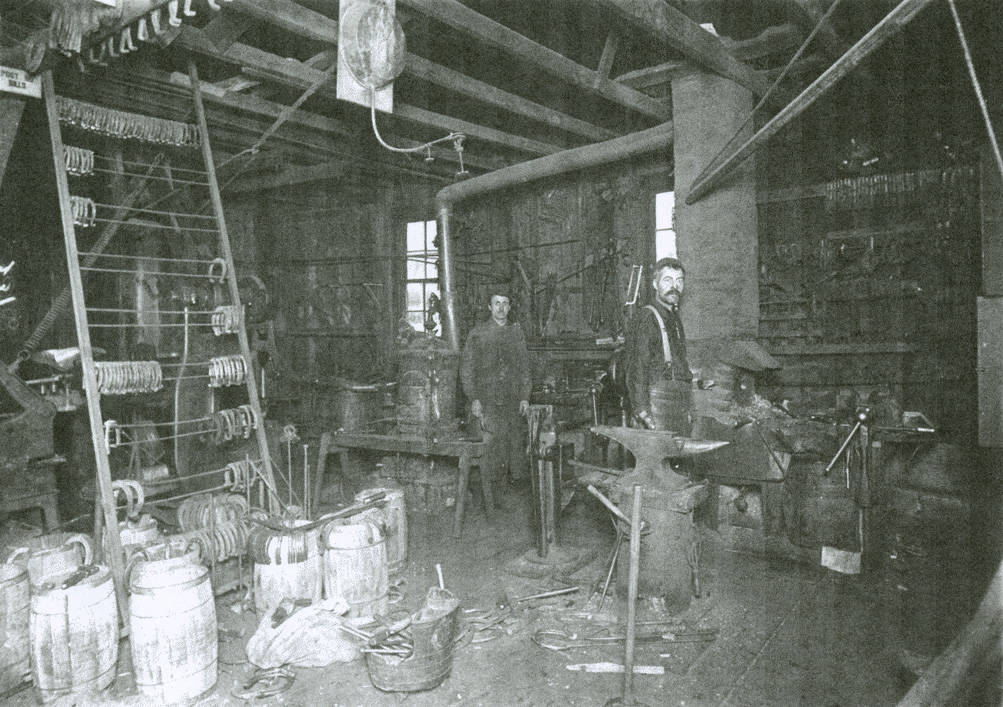 Charles_J_Hall_and_his_blacksmith_shop_Rosalia_Washington_circa_19201923