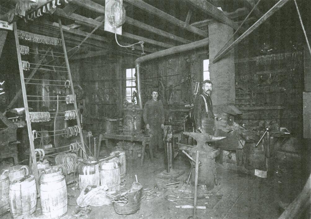 Charles_J_Hall_and_his_blacksmith_shop_Rosalia_Washington_circa_19201923