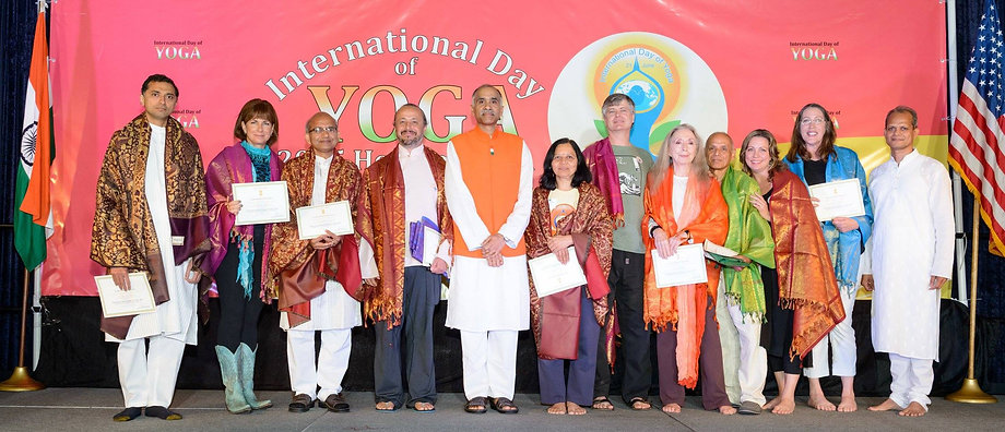 Jenny & other yogis receiving recognition at International Day of Yoga.