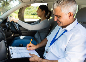 What do driving examiners look for during a driving test?