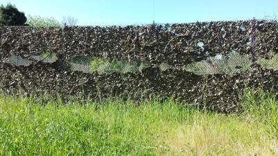 Fence at Coyote Meadows covered with lea