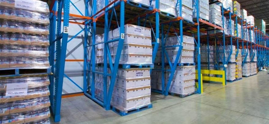 STRUCTURAL DRIVE-IN RACK WITH DOUBLE STACK BOTTOM PALLETS ON FLOOR