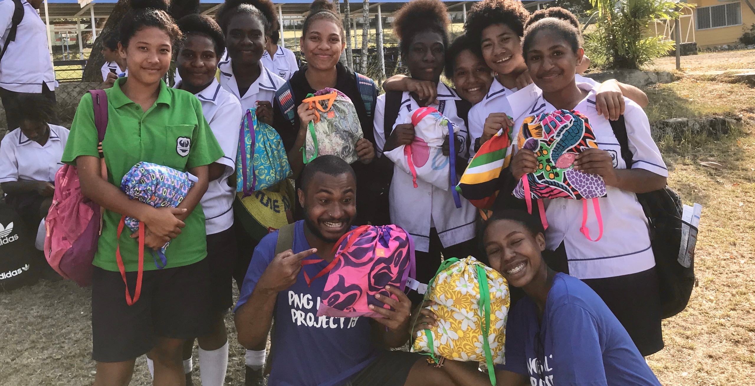 PHP 2019 team and students holding the beautiful reusable period kits from Days for Girls.