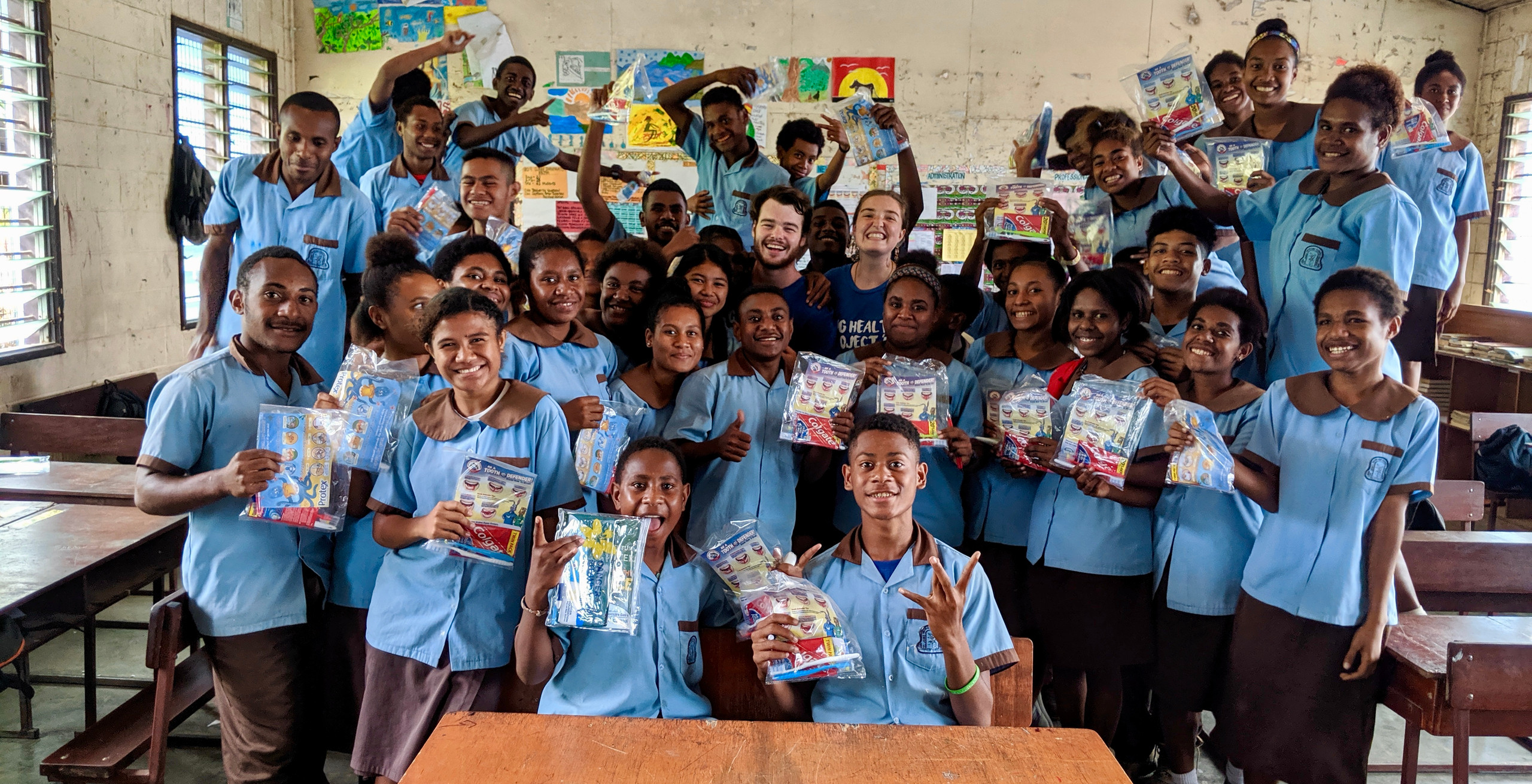 General Health/Hygiene station and kids from St Johns Primary School with the Dental Kits donated by Colgate.