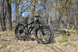 Surly Wednesday with  1x11 Box Components drivetrain and orange Wolftooth Components accents.