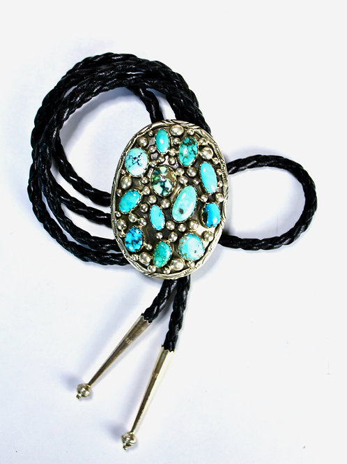 CLUSTER NAKAI NAVAJO TURQUOISE AND LEATHER BOLO