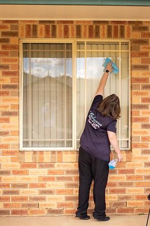 Taylah cleaning window.jpg