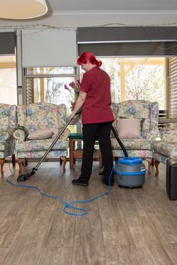 Amanda vacuuming Ganya.jpg