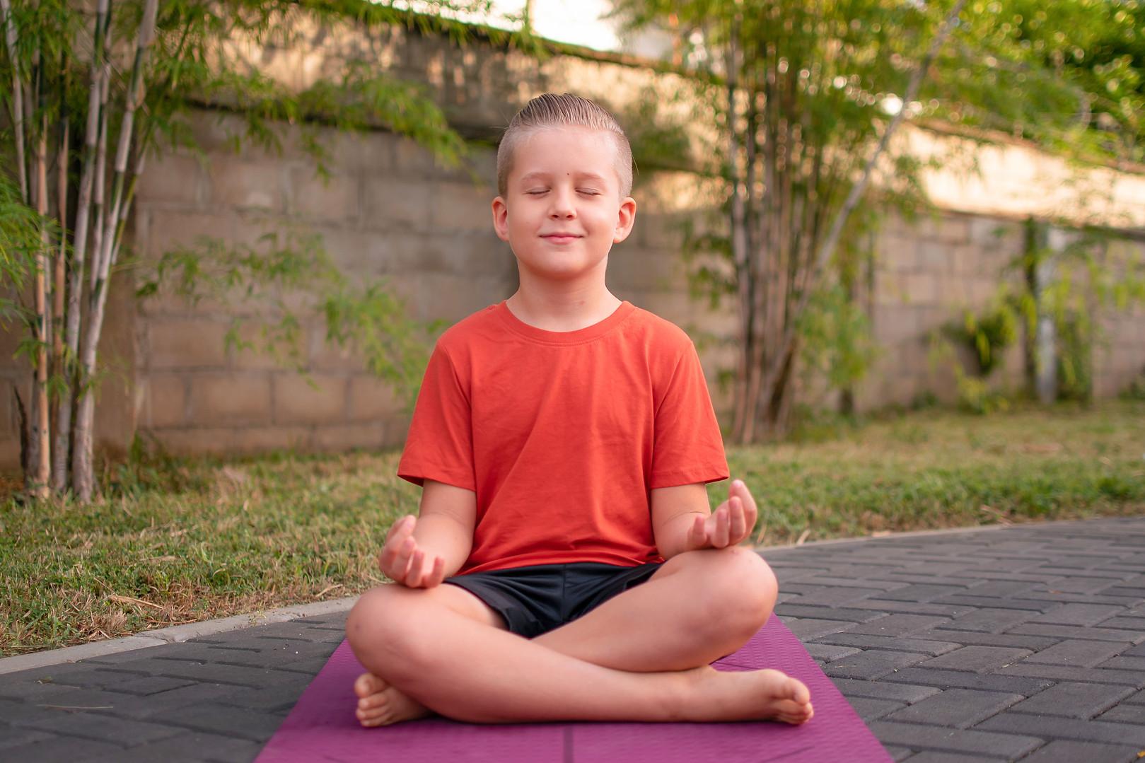 Meditating Child At Yoga Peetha Happiness Centre