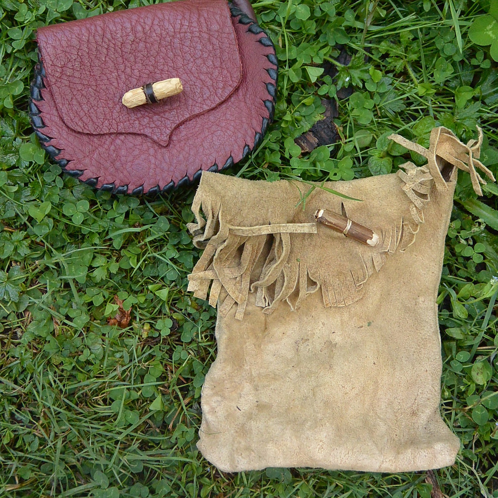 Buckskin leather pouch made from goat hide rescued from compost. Other pouch hand sewn from leather offcuts.
