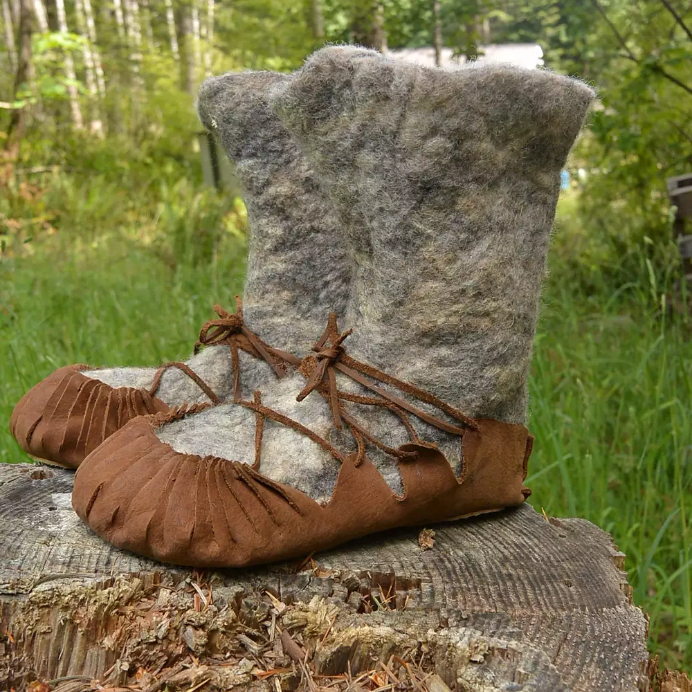 Wet felted woolen boots. Handmade leather covering adjusts to boot or bare foot.