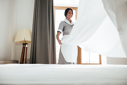 hotel-maid-changing-bed-sheet.jpg