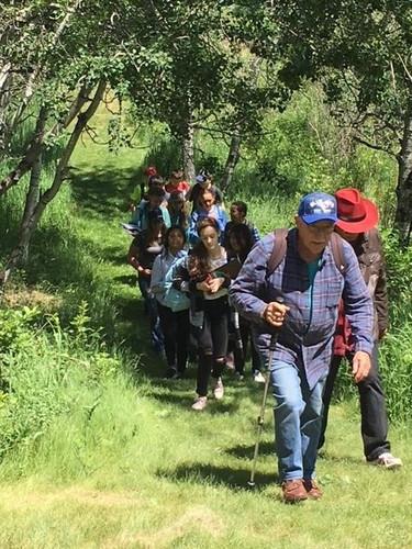 students hiking at JJ Collett