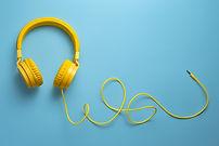 Desmond is Amazing Yellow headphones on blue background. Mu