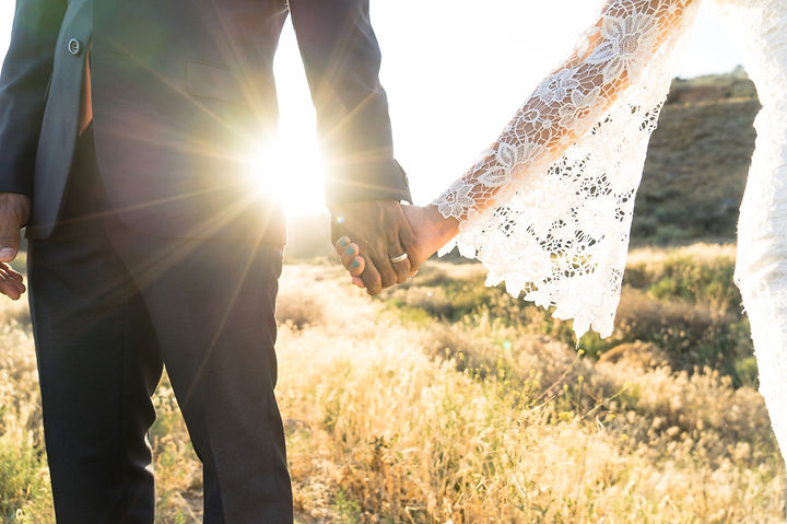 Interracial-couple-holding-hands-at-wedd