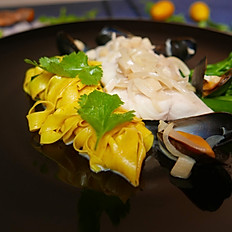 Poached turbot, tarmac tagliatelle, with a creamy mussels braisage.
