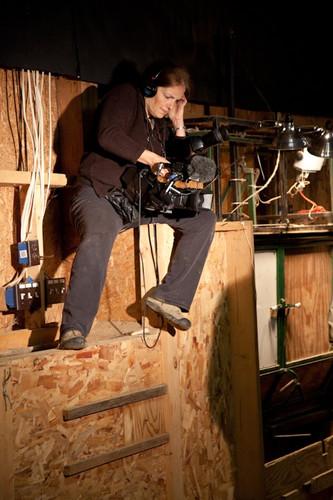 Filming deer round-up in barn