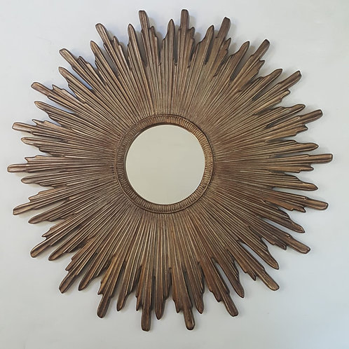Round wooden sunburst mirror