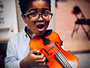 Ellison testing out a violin under his neck for the first time!