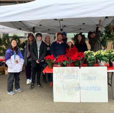 Selling Wreaths & Pointsettias at Ballard Market 2019