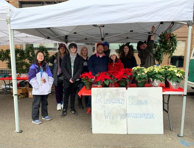 Selling Wreaths & Pointsettias at Ballard Market 2019