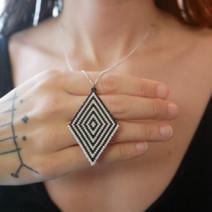 Hypnotic beadwoven pendant