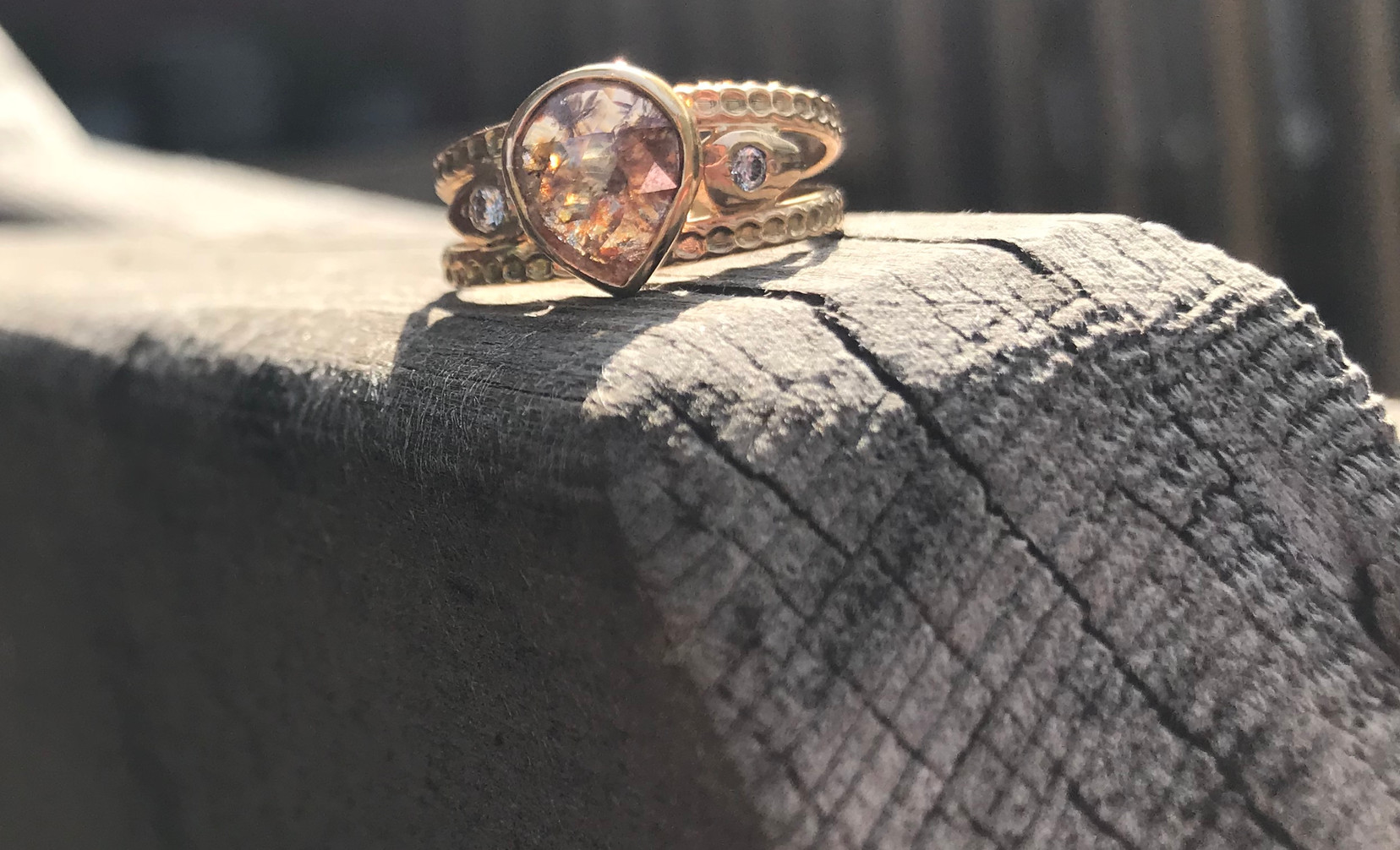 Tear Shaped Rustic Diamond and White Diamonds in Gold