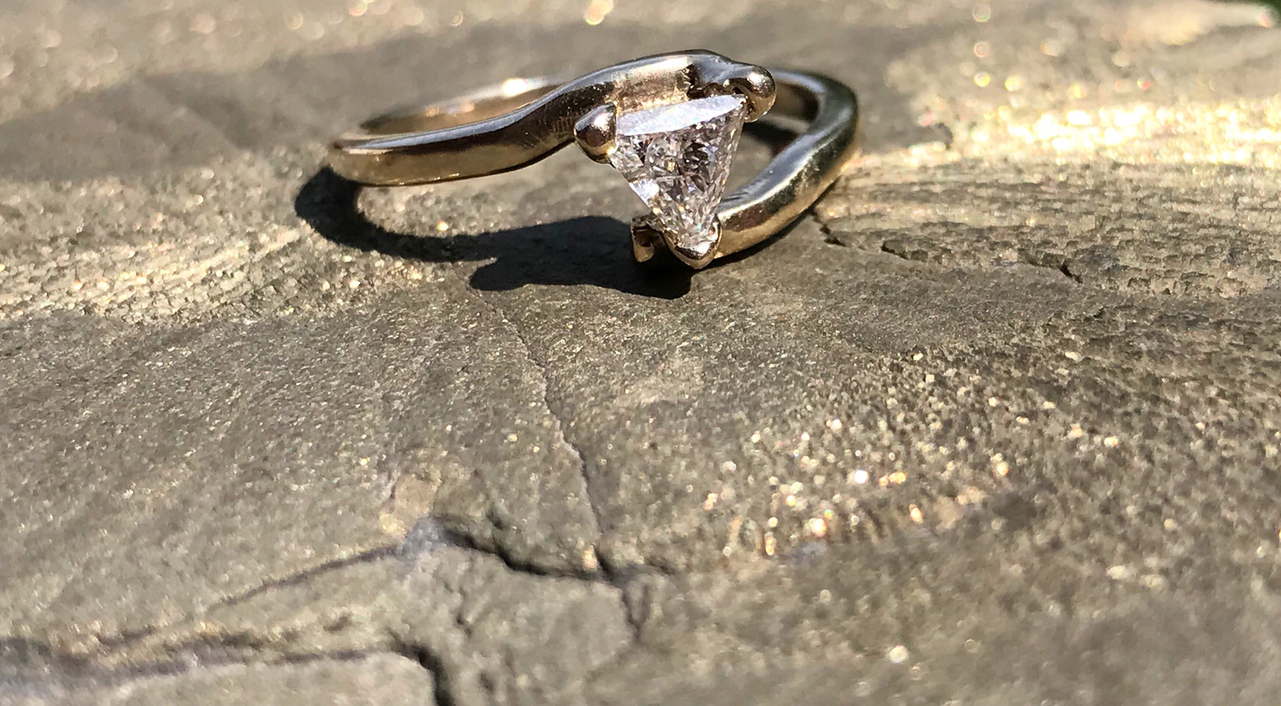 Triangle Diamond set in a Yellow Gold Band