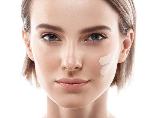 63467839-skin-tone-cream-lines-on-woman-