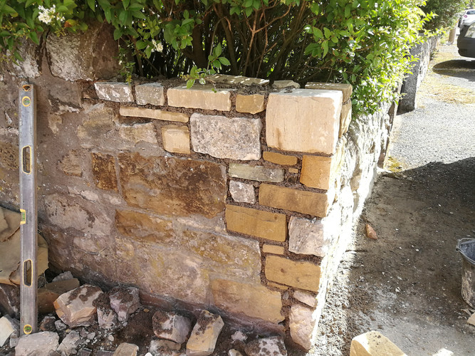 Repairs to corner section of rubble wall